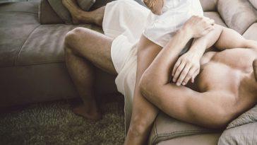 woman laying ontop of a man