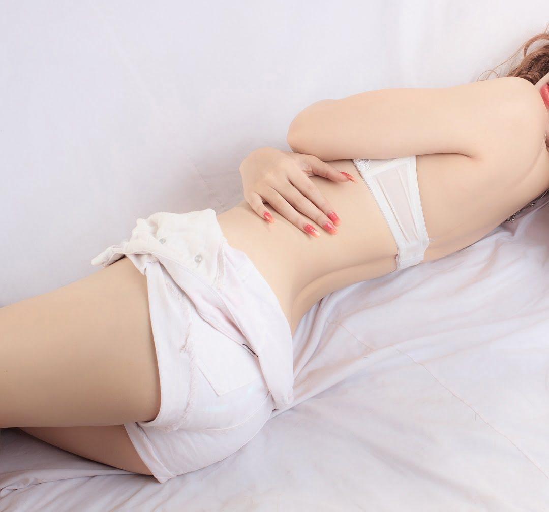 beautiful girl laying on bed