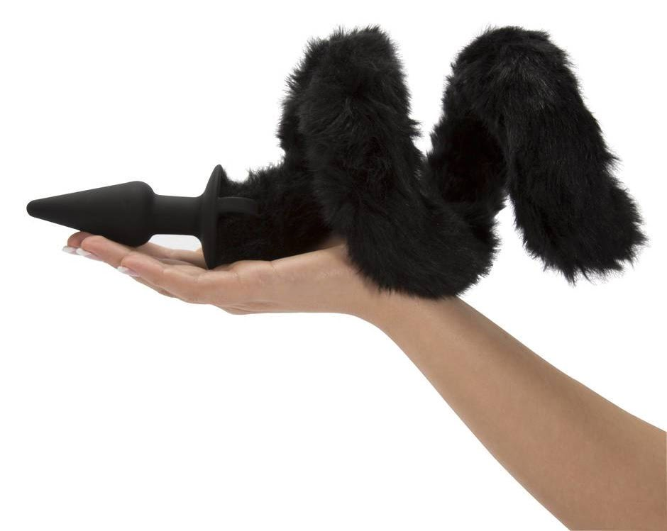 cat tail butt plug in womans hands