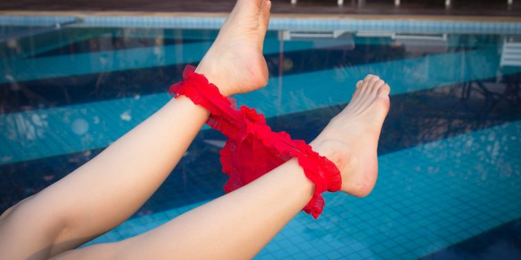 girl with underwear around her ankles next to pool