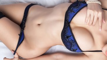 woman in sexy lingerie laying on bed