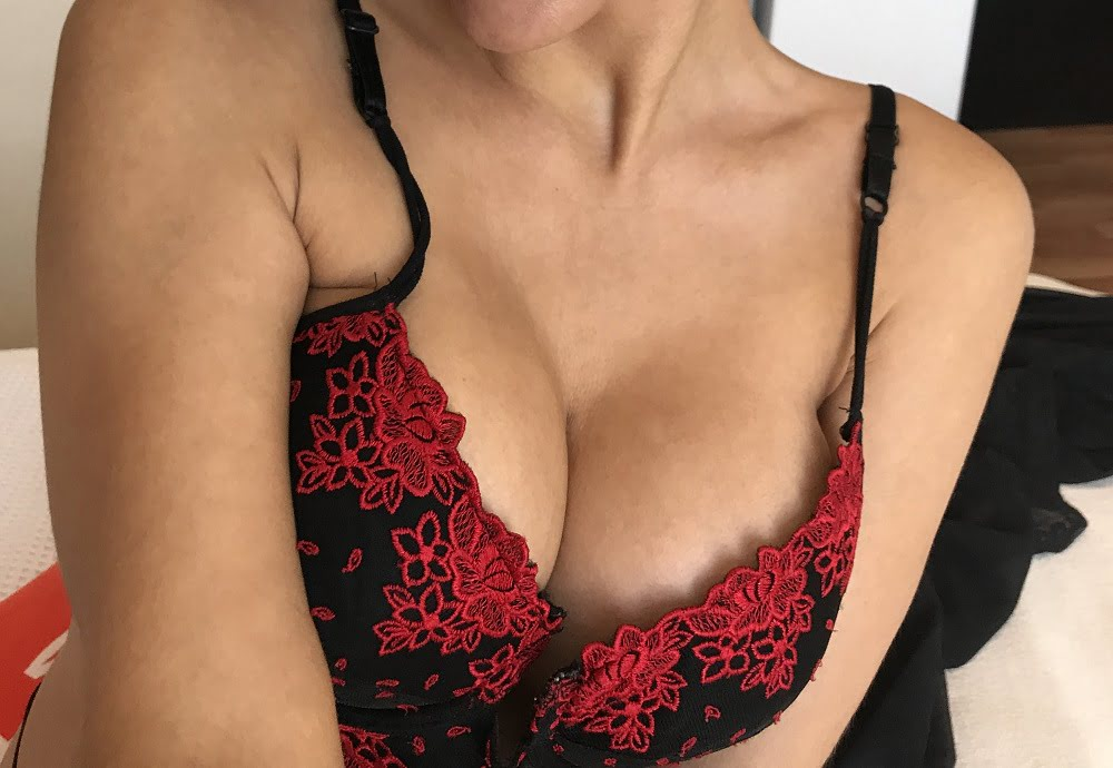woman in beautiful red and black floral bra