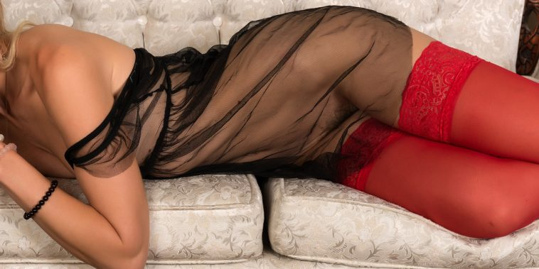 woman in sheer night dress with red stockings