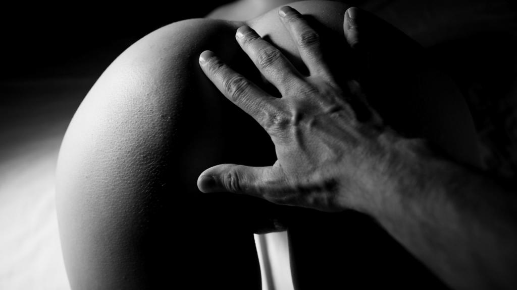 man spanking womans ass