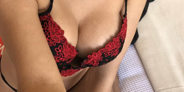 woman in red and black flowery bra