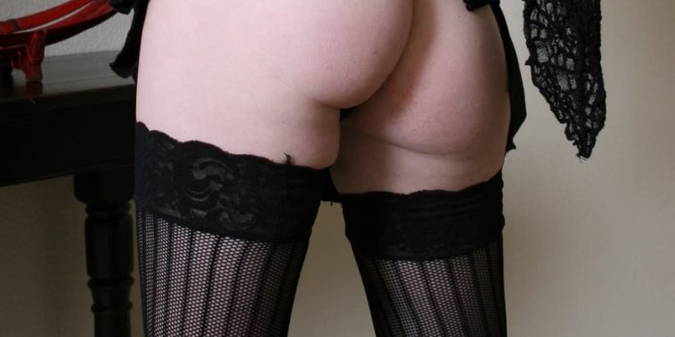picture of womans butt in red thong and black stockings
